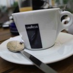 Lavazza_cup_with_little_spoon_in_café_Pod_Obrazy_in_Brno